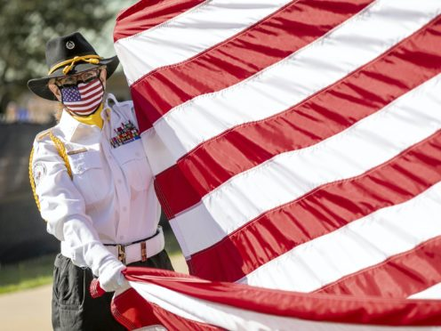 Alana Pompa of the Jewish War Veterans Post 757 participates in a Veterans Day flag-raising ceremony at the Dell Jewish Community Campus in Austin, Texas (Jay Janner/Austin American-Statesman via AP)