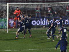 Scotland players embrace goalkeeper David Marshall (Novak Djurovic/PA)