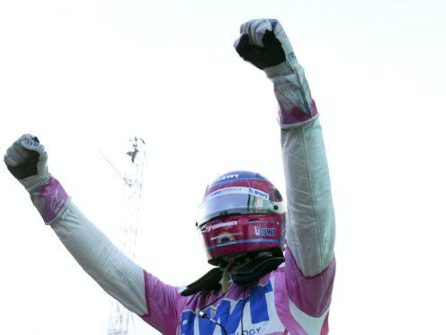 Lance Stroll celebrates taking pole (Clive Mason/AP)