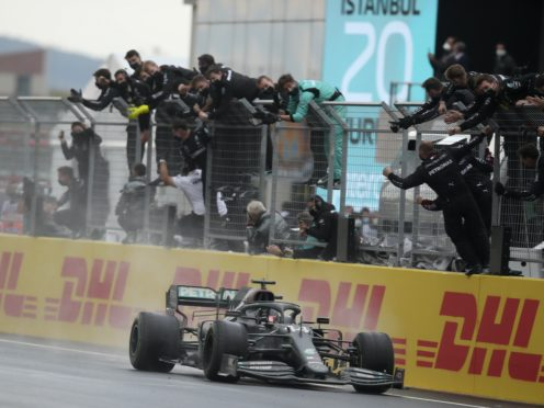 Lewis Hamilton is one of Britain's sporting greats (Tolga Bozoglu/Pool via AP)