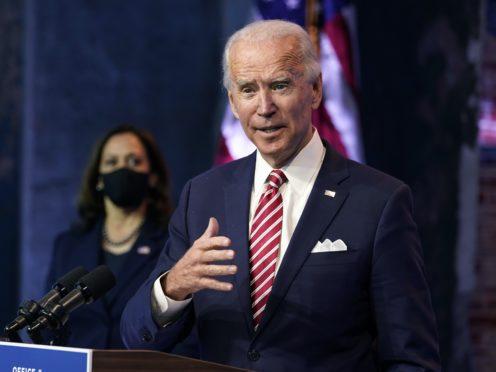 President-elect Joe Biden, accompanied by Vice president-elect Kamala Harris, speaks in Wilmington, Delaware (Andrew Harnik/AP)