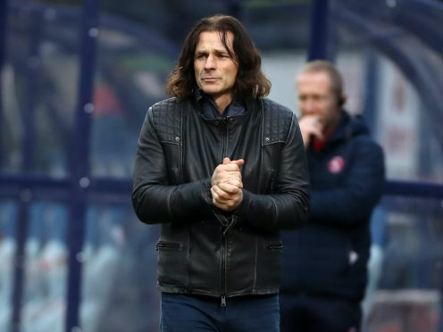 Wycombe manager Gareth Ainsworth made a return to the touchline on Saturday after injury (PA)