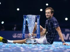 Daniil Medvedev poses with the Nitto ATP Finals trophy (John Walton/PA)