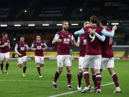 Burnley's Chris Wood (9) celebrates with his team-mates (Jan Kruger/PA)