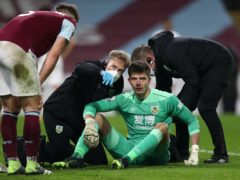 Nick Pope receives treatment after taking a knock to the head (Jan Kruger/PA)