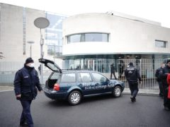 The car had slogans written on it (Michael Kappeler/dpa via AP)