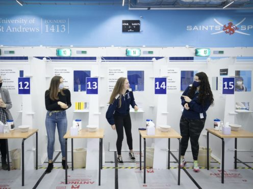 Students get a Covid-19 test at a mass testing centre set up at the sports centre at St Andrews University, ahead of the Christmas holiday (Jane Barlow/PA)