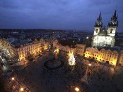 A Christmas tree illuminates the Old Town Square in Prague (Petr David Josek/AP)