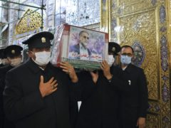 The coffin of Mohsen Fakhrizadeh is carried during a funeral ceremony in Mashhad, Iran (Iranian Defense Ministry via AP)