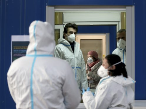 Medical workers at a site for coronavirus testing in Vienna, Austria (Ronald Zak/AP)