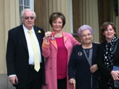 Delia Smith, with (from left) her husband Michael Wynn Jones, mother Etty Smith and manager Melanie Grocott, after she received her Commander of the British Empire Medal (CBE) from the Prince of Wales at an investiture ceremony at Buckingham Palace in 2009 (PA Archive)