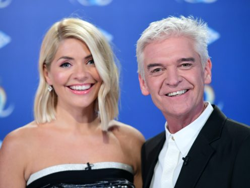 Holly Willoughby and Phillip Schofield spread festive joy in the first-ever This Morning Christmas special (Ian West/PA)