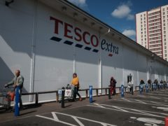 Tesco has said it will hand back the savings from the Government's business rates holiday (Yui Mok/PA)