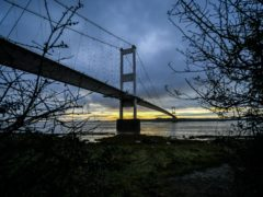 The sun rises over the Severn crossing in October (Ben Birchall/PA)