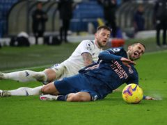 Liam Cooper, left, has been ruled out of Leeds' home Premier League game on Sunday (Molly Darlington/PA)
