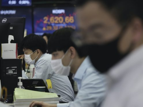 Currency traders watch monitors at the foreign exchange dealing room of the KEB Hana Bank headquarters in Seoul (Ahn Young-joon/AP)