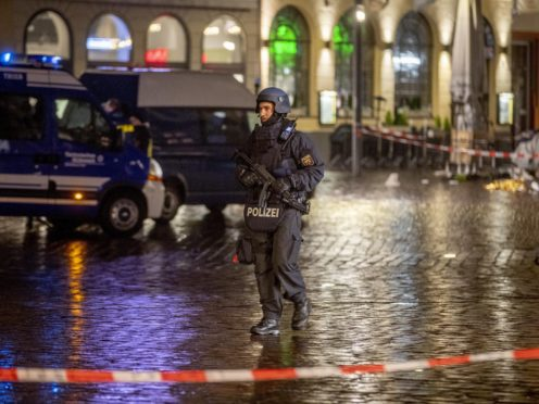A police officer guards evidence at the scene of an incident in Trier (Michael Probst/AP)