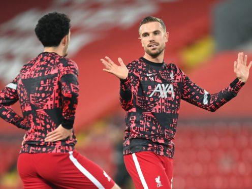 Liverpool captain Jordan Henderson talking to youngster Curtis Jones (Michael Regan/PA)