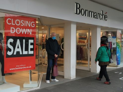 Shoppers at Bonmarche in Farnborough, advertising its closing down sale (Adam Davy/PA)