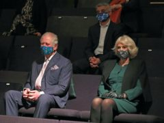 The Prince of Wales and Duchess of Cornwall with Mayor of London, Sadiq Khan (rear, centre), watch a short rehearsal performance, during a visit to the Soho Theatre in London. Chris Jackson/PA Wire