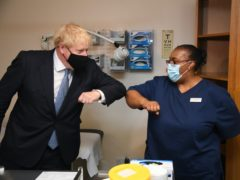 File photo dated 24/07/20 of Prime Minister Boris Johnson elbow bumping Lead Nurse Marina Marquis during a visit to Tollgate Medical Centre in Beckton in East London. December 13th 2020 marks the first anniversary of Mr Johnson's General Election win.