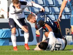 Ross County's Michael Gardyne clashed with Alfredo Morelos (Jeff Holmes/PA)