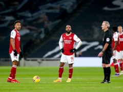 Pierre-Emerick Aubameyang, left, and Alexandre Lacazette appear dejected during Arsenal's derby defeat by Tottenham (Catherine Ivill/PA)