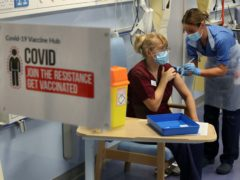 Deputy charge nurse Katie McIntosh administers the Pfizer/BioNTech Covid-19 vaccine at the Western General Hospital, in Edinburgh (Andrew Milligan/PA)