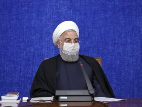 President Hassan Rouhani has said US sanctions are making it difficult for Iran to purchase medicine and health supplies from abroad, including Covid-19 vaccines needed to contain the worst outbreak in the Middle East (Iranian Presidency Office/AP)