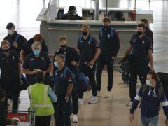 England's cricket team depart the International Airport in Cape Town (Nardus Engelbrecht/AP)