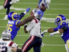 Los Angeles Rams defensive end Aaron Donald (99) and linebacker Obo Okoronkwo (45) pressure New England Patriots quarterback Cam Newton (1) (Keith Birmingham/The Orange County Register via AP)
