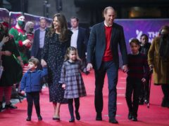The Duke and Duchess of Cambridge and their children, Prince Louis, Princess Charlotte and Prince George attend a special pantomime performance (Aaron Chown/PA)