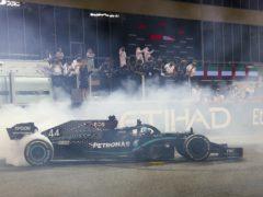 Lewis Hamilton plans to remain with Mercedes next season (Giuseppe Cacace/AP)