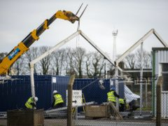 Construction workers building a temporary Border Control Post (BCP) at Larne Harbour (Liam McBurney/PA).