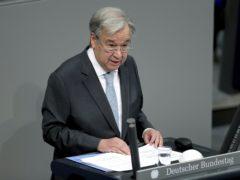 Antonio Guterres heaped praise on German Chancellor Angela Merkel (Michael Sohn/AP)
