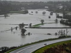 Flooded fields after the River Towy burst its banks in Carmarthenshire (Ben Birchall/PA)