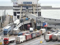 Lorries leave a ferry in Dover (PA)