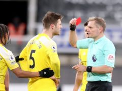 Joachim Andersen is shown a red card by referee Graham Scott (Alex Pantling/PA)