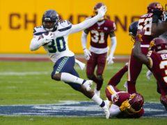 Seattle running back Carlos Hyde breaks a tackle to begin a 50-yard touchdown run in Seattle's defeat of Washington (Susan Walsh/AP)