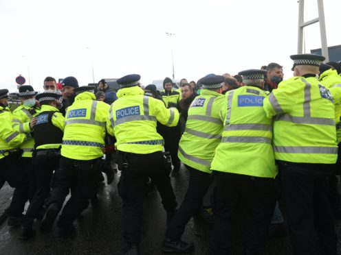 Police scuffle with lorry drivers outside the Port of Dover in Kent (Andrew Matthews/PA)