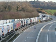 Freight lorries lined up on the M20 near Ashford (PA)