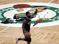 Brooklyn Nets' Kyrie Irving brings the ball up during the first half of the team's NBA basketball game against the Boston Celtics (Michael Dwyer/AP)
