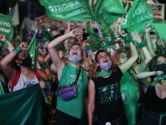 Activists watch the Senate vote unfold in Argentina (AP Photo/Natacha Pisarenko)