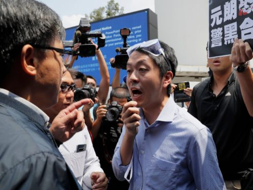 Ex-Hong Kong lawmaker plans to go into exile in Britain (Kin Cheung/AP)