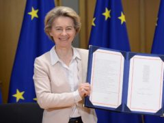 European Commission President Ursula von der Leyen shows the signed EU-UK Trade and Co-operation Agreement at the European Council headquarters in Brussels (Johanna Geron, Pool Photo via AP)
