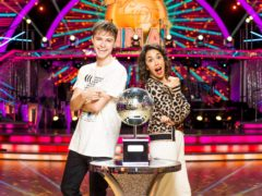 HRVY and Janette Manrara with the Strictly Come Dancing glitterball trophy (Guy Levy/BBC/PA)