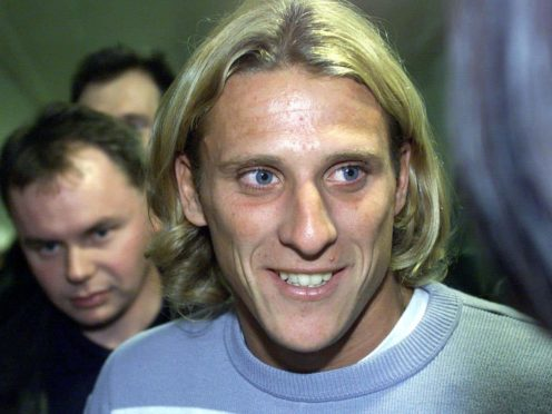 Diego Forlan arrives at Manchester Airport. having opted to join Manchester United ahead of Middlesbrough (Martin Rickett/PA)