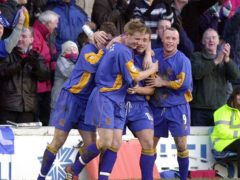 Shrewsbury's Nigel Jemson (number 10) is mobbed by team-mates after scoring against Everton in 2003 (David Jones/PA)