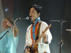 Prince performing on stage at the Brit Awards (PA)