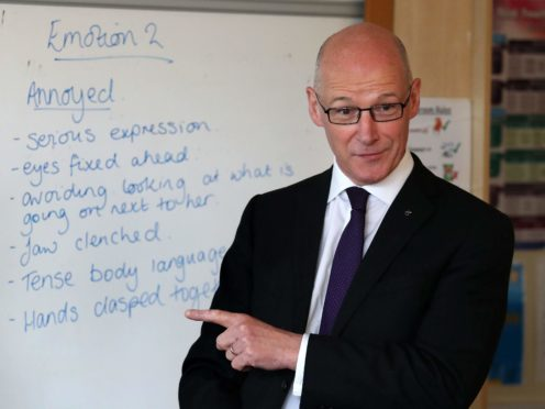 Education Secretary John Swinney said he wants to give two weeks' notice before further reopening schools (Andrew Milligan/PA)